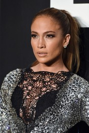 Jennifer Lopez pulled her hair back into an edgy pony for the Tom Ford womenswear presentation.
