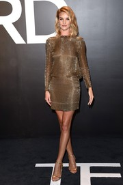Rosie Huntington-Whiteley looked chic and statuesque in a gold chainmail mini dress by Tom Ford during the label's womenswear presentation.