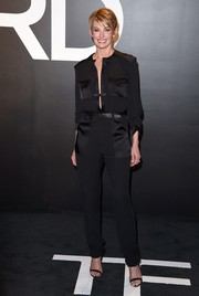 Faith Hill chose a military-chic black Tom Ford jumpsuit for the label's womenswear presentation.