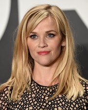 Reese Witherspoon sported messy straight layers with side-swept bangs at the Tom Ford womenswear presentation.