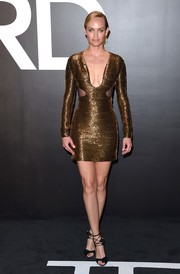 Amber Valletta oozed sex appeal in a form-fitting gold cutout dress by Tom Ford during the label's womenswear presentation.