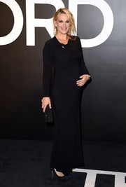 Molly Sims sheathed her pregnancy curves in a long-sleeve black gown by Tom Ford for the brand's womenswear presentation.