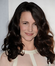Kristin Davis styled her brunette locks in bouncy curls at the Tom Ford store opening.