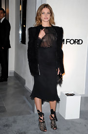 Natalia Vodianova looked exotic at the Tom Ford Bevery Hills store opening in lace peep toe sandals with sultry wrap around ties.