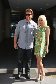 "Tori Spelling posed with husband Dean outside of the ""Today Show"". She showed off her paisley print frock and strappy sandals."