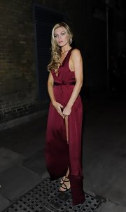 Abbey Clancy looked sultry at the Total Management Lingerie Launch in a wine-colored evening dress with an up-to-there slit.