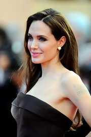 Angelina Jolie paired her long locks with dangling diamond earrings at the Cannes Film Festival.