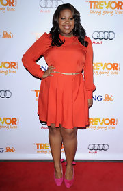 Amber Riley was a vibrant beauty in an orange long-sleeve frock paired with fuchsia pumps for the Trevor Live benefit in LA.