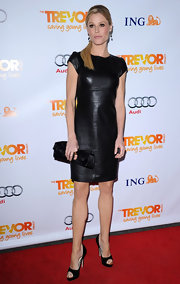 Julie Bowen softened her sexy black leather dress with an elegant satin clutch.