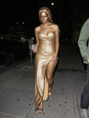 Leona Lewis matched her sexy strapless dress with a pair of gold platform sandals.