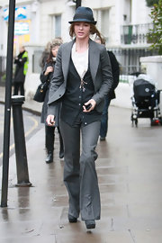 Trinny Woodall chose a gray pantsuit and a hat for a rainy day stroll.