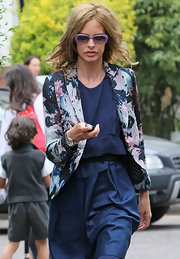 Trinny Woodall went on the school run looking chic in a print blazer layered over a navy dress.