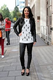 Tulisa went for the leather-on-leather look by finishing her skinnies with a sleek motorcycle jacket.