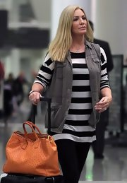 Shannon Tweed transformed a simple tee and pants ensemble by wearing a gray vest.