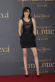 Kristen adds color with these pumps which breaks the monotony of this otherwise all-black look.