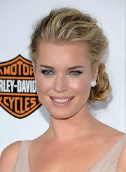 Rebecca Romijn attended the premiere of 'Good Deeds' wearing her hair in a chic slightly mussed loose side bun.