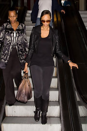 Tyra looked cozy in a cropped black leather jacket as she arrived at LAX.
