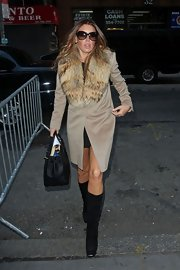 "Rachel Uchitel hit the ""Today Show"" in a pair of black suede knee high boots. She paired the boots with a glam fur trimmed jacket."