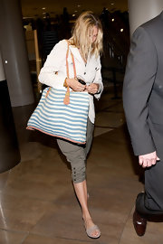 Uma Thurman toted a beachy blue-and-white striped bag with tan handles through LAX.