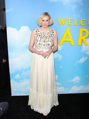 Gwendoline Christie looked adorable in a white Miu Miu gown with a pearl-studded bodice and waist cutouts at the premiere of 'Welcome to Marwen.'