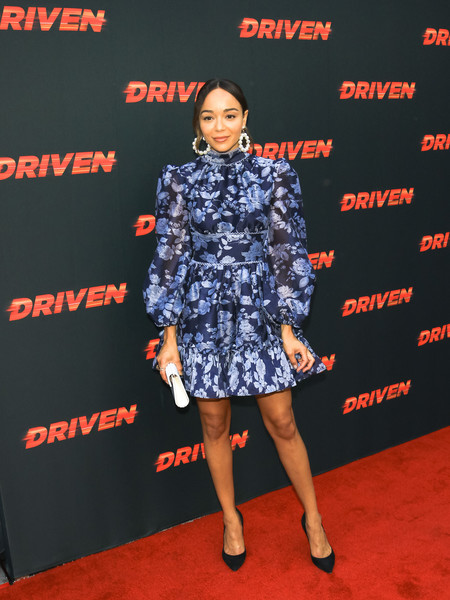 Ashley Madekwe charmed in a blue print dress by Keepsake The Label at the premiere of 'Driven.'