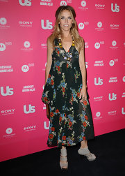 Cheryl wore a flowery black silk dress to the US Weekly Hot Hollywood party