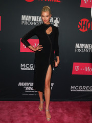 Karlie Kloss styled her edgy-sexy dress with strappy silver heels by Giuseppe Zanotti.