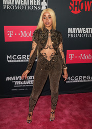 Gold T-strap sandals sealed off Cardi B's head-turning look.