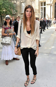 Bianca Brandolini D'adda had a casual approach to style at the Valentino Haute Coture show in a pair of cuffed jeans and black studded sandals.