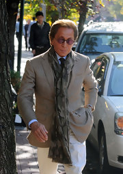 Valentino kept on trend with his military style scarf.