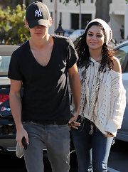 Vanessa Hudgens wore a cream beanie with an off-the-shoulder sweater while out to get breakfast with her boy.