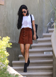 Vanessa Hudgens teamed her top with a brown suede mini skirt.