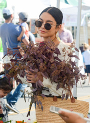 Vanessa Hudgens was hippie-chic in her round sunnies while buying flowers at a farmers market.