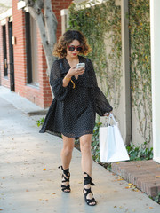 Vanessa Hudgens finished off her outfit with strappy black sandals by RAYE x For Love & Lemons.