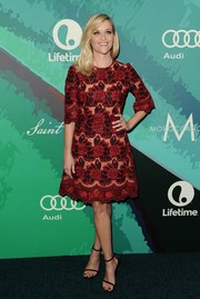 Reese Witherspoon exuded ultra-feminine appeal in a floral-embroidered A-line dress by Dolce & Gabbana at the Variety Power of Women event.