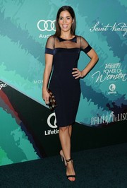 Ana Ortiz paired her dress with simple black ankle-strap sandals.