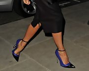 Victoria Beckham added some color to her monochromatic look with purple and black pumps.