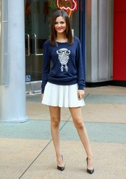 Victoria Justice was casual yet cute in a French Connection owl sweater during her appearance on 'Extra.'
