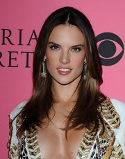 Alessandra Ambrosio brightened up her smile with a warm rosy lipstick at the Victoria's Secret fashion show viewing party.