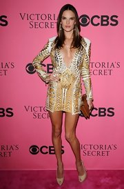 Alessandra topped off her sexy gold frock with nude peep-toe slingbacks.