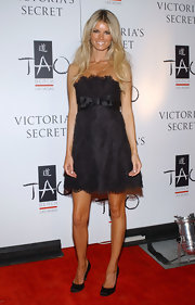 Marisa Miller paired her lace clad dress with satin pumps at the What is Sexy event hosted by Victoria's Secret.