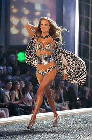 Alessandra stacked on the bling for this dramatic runway look at the Victoria's Secret fashion show.