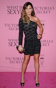 Daisy Fuentes put a spin on the classic lace dress with this single-sleeve design at the Victoria's Secret 'What Is Sexy?' party.