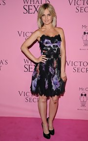 Mena Suvari looked romantic and sexy in this lace-trimmed floral dress at the Victoria's Secret 'What Is Sexy?' party.