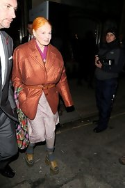Vivienne Westwood completed her quirky ensemble with a pair of tan platform sandals.