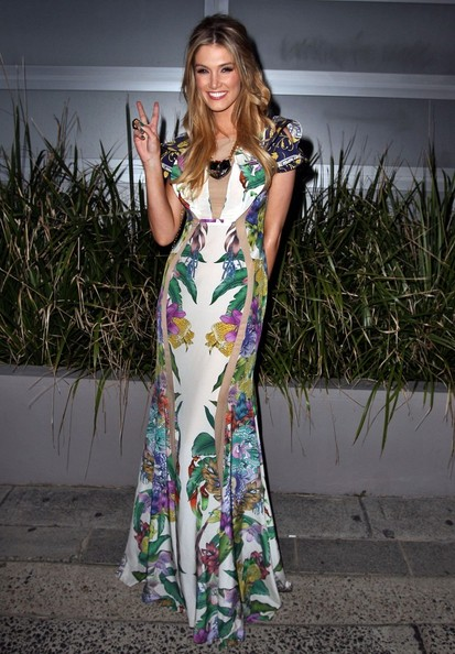 Delta Goodrem went for an ultra-feminine look with this colorful floral evening dress at the 'Voice' cocktail party in Australia.