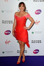 Jelena Jankovic completed her red-themed outfit with pumps and a clutch.