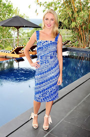 Naomi Watts paired her print dress with a pair of pretty ivory sandals, with ribbon ankle ties.