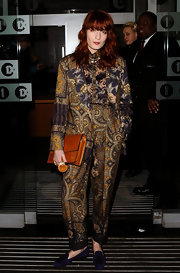 Florence Welch attempted to temper her bold prints with a classic leather satchel.
