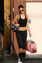 Nicole Scherzinger is seen leaving dance practice showing off her fit body. She topped her killer bod' off with an edgy chain strap shoulder bag.